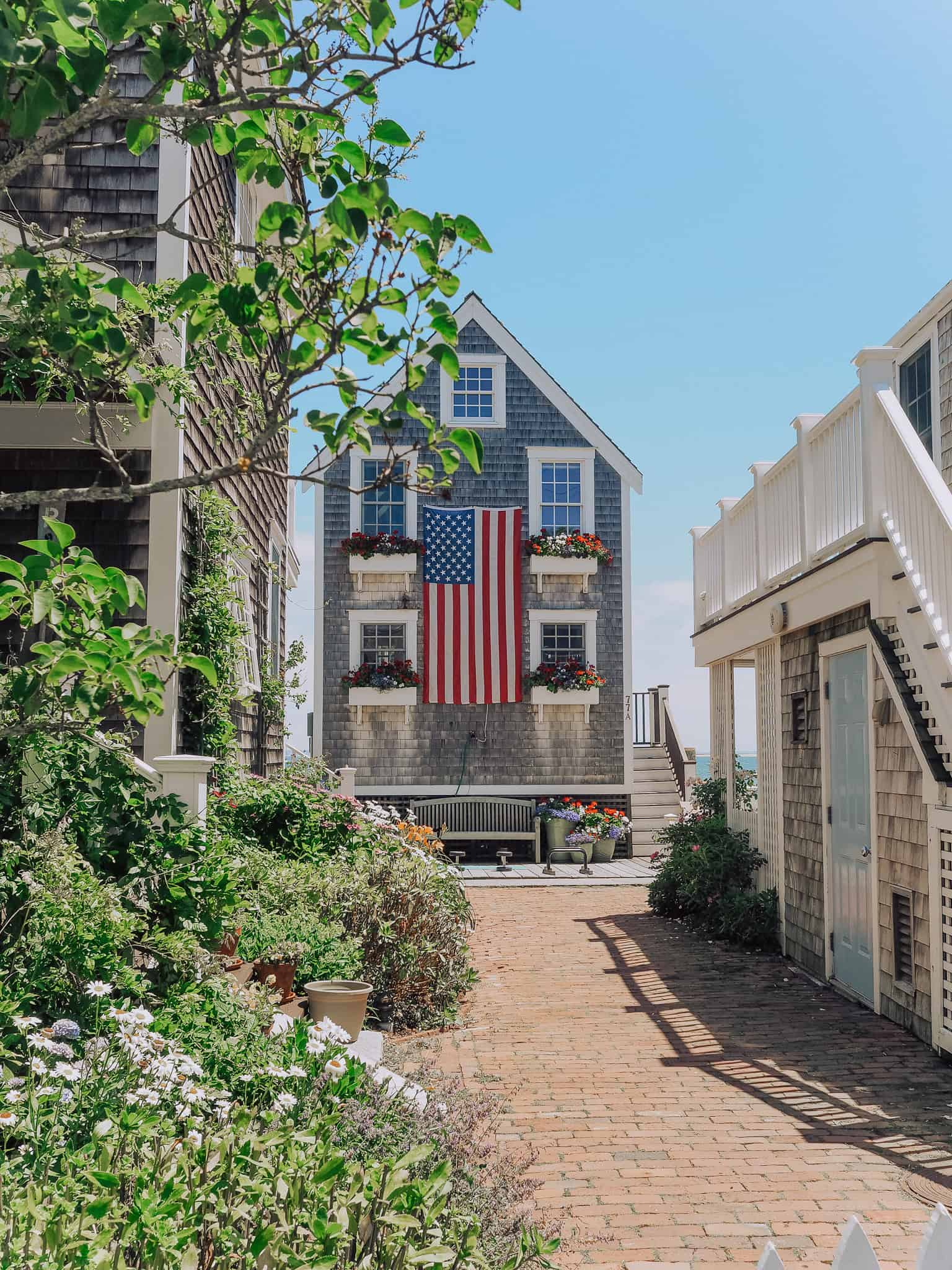 Quintessential Cape Cod Homes: Continue on Commercial Street in Provincetown, Massachusetts heading for Captain Jack's Wharf and you'll find beautiful coastal homes. Where you can find the famous American flag home tucked away.