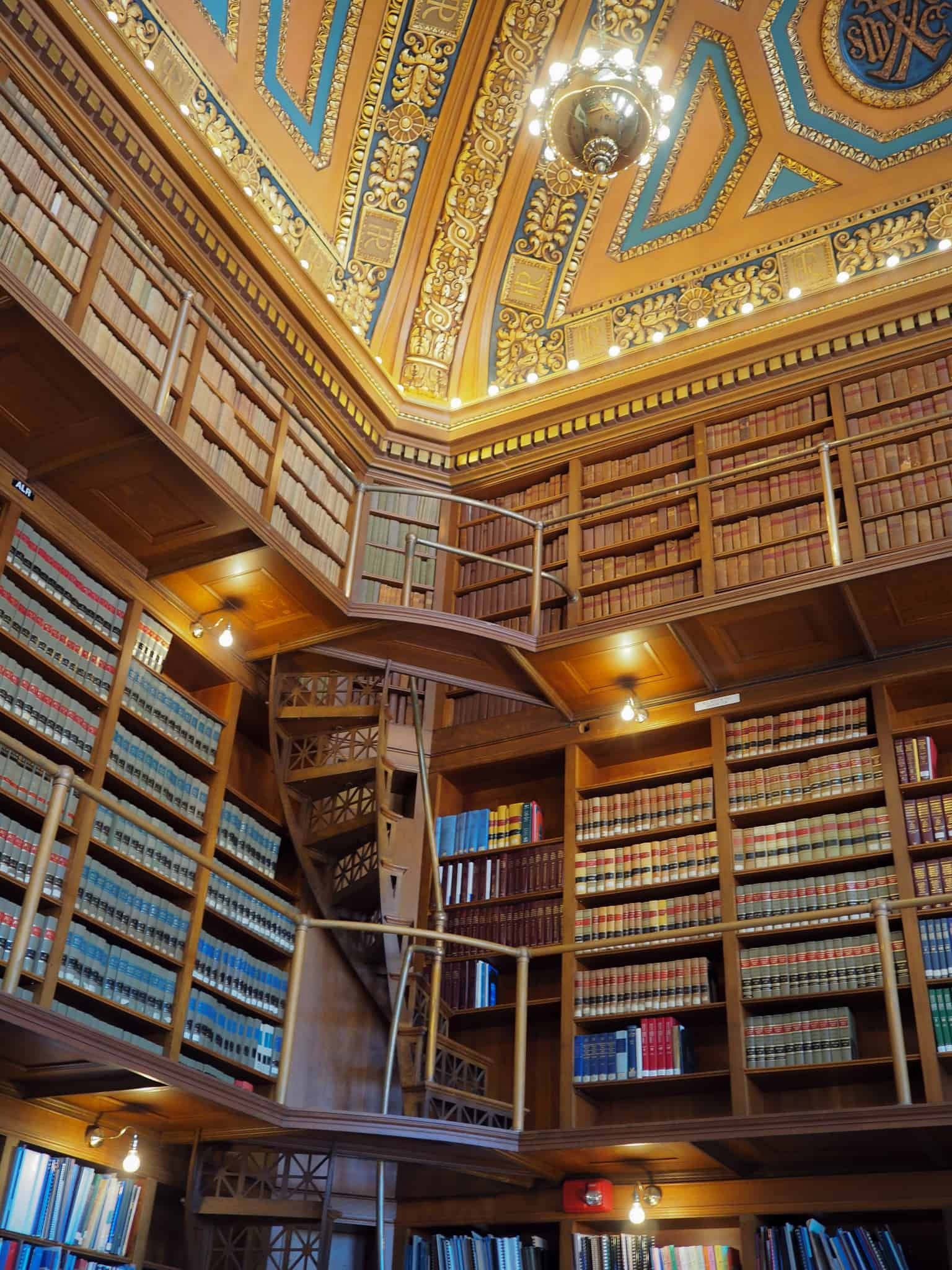 The State House Library: Intricate in detail three tiered room with books on each level. The library houses official documents and records of the United States. The library is also part of the Secretary of State's office.